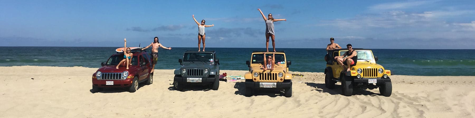 Jeep owners on beach with Jeeps